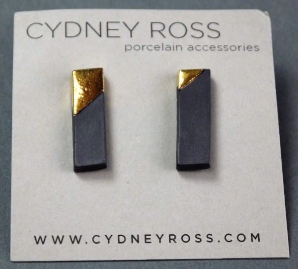 Graphite & Gold | Burnished Metallic Studs - Graphite & Gold | Burnished Studs are crafted in small batches and feature accents of glaze and metallic lusters. The sections of raw porcelain are burnished by hand to a luscious finish. - by Cydney Ross